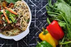 stir fried noodles with crunchy vegetables in black bean sauce