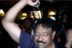 VIDEOS: Ram Gopal Varma Pours Champagne On Himself After Watching ISmart Shankar; Gets TROLLED