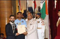 Virat Kohli receives Khel Ratna from president Ram Nath Kovind while Anushka Sharma applauds; see pics